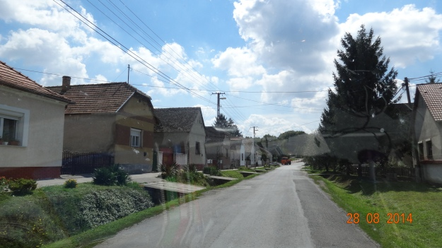 Hungarian villiages often stretch out for miles along the single road that pases through them. Why build unnecessary roads? Makes walking to the shop a bit of a hike for some though!
