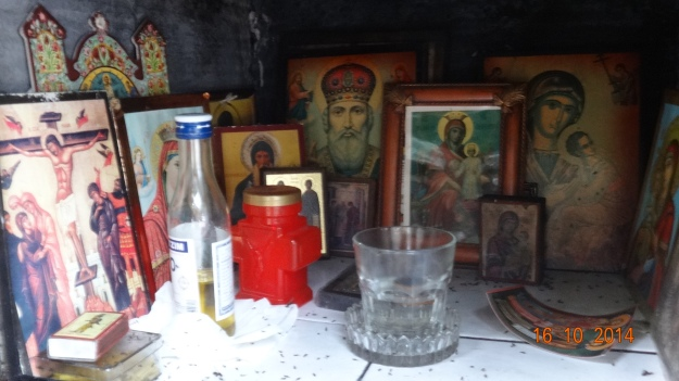 ..but still full of various icons ..and that's not a small bottle of ouzo for passing travellers, its olive oil for the perpetually burning lamp