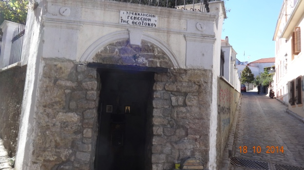 the entrance to a tiny church, built into the wall of something else