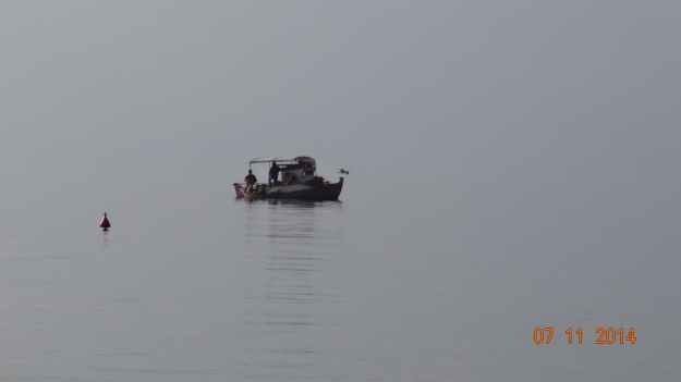 a very grey day - there's a horizon out there somewhere. And so still! Although this is the sea it seems more like a lake.