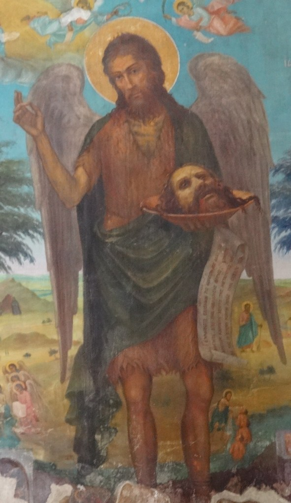 Unusual! fresco in the little church here. We're getting used to gruesome pictures of John the Baptist's severed head, but he himself is not normally holding it! I suppose the wings are supposed to represent him in his spirit form? so it just about 'works'