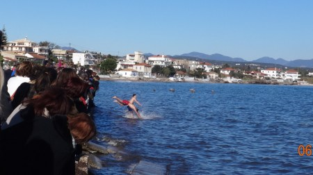 Diving into the icy waters to retrieve the cross