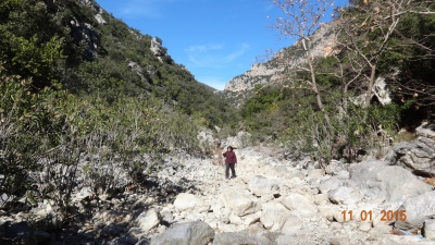 walking in the dry riverbed below the monastery