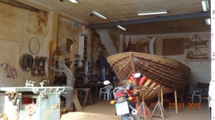 They're still making the traditional wooden boats. Note the hand-made curves hanging on the wall. You hardly ever see a plastic fishing boat here.