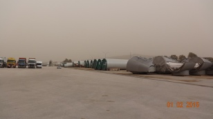 The harbourside on not such a good day - huge wind turbine parts lined up.