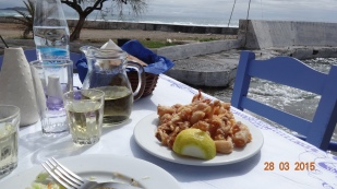fried squid, a glass of local white, and sunshine!