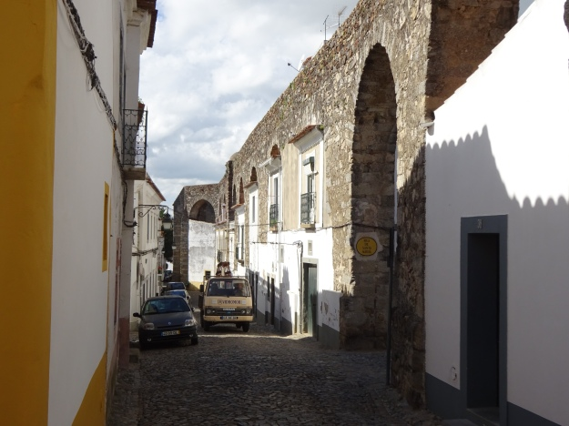 houses built into the arches beneath the aqueduct bringing water into the town.