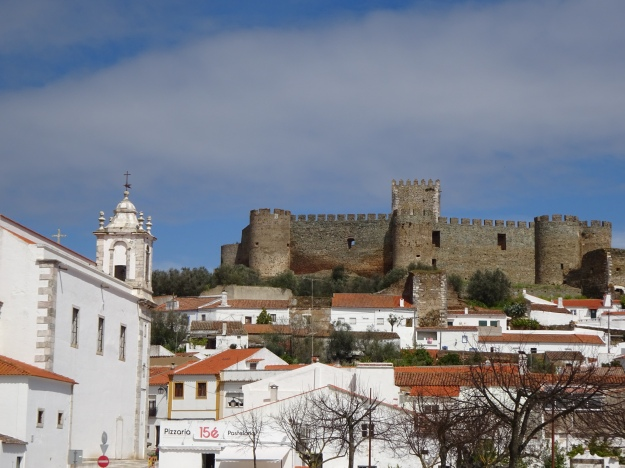 One of many typical small towns, topped off with a castle (Portel)